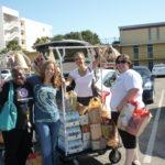 pwn-usa leaders joyfully toting event supplies